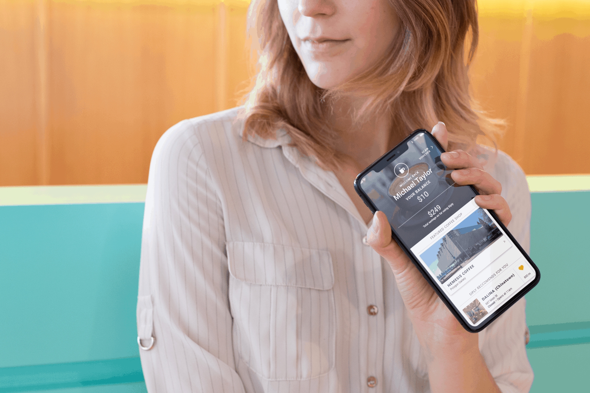Woman holding Siply app